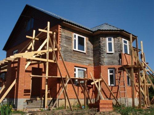 Обкладка деревянного дома кирпичом. Как обложить дом? в фото