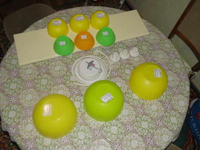 Самодельная бюджетная люстра на кухню из салатниц в фото