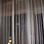 Оформление окон в зале: рекомендации по выбору тюли